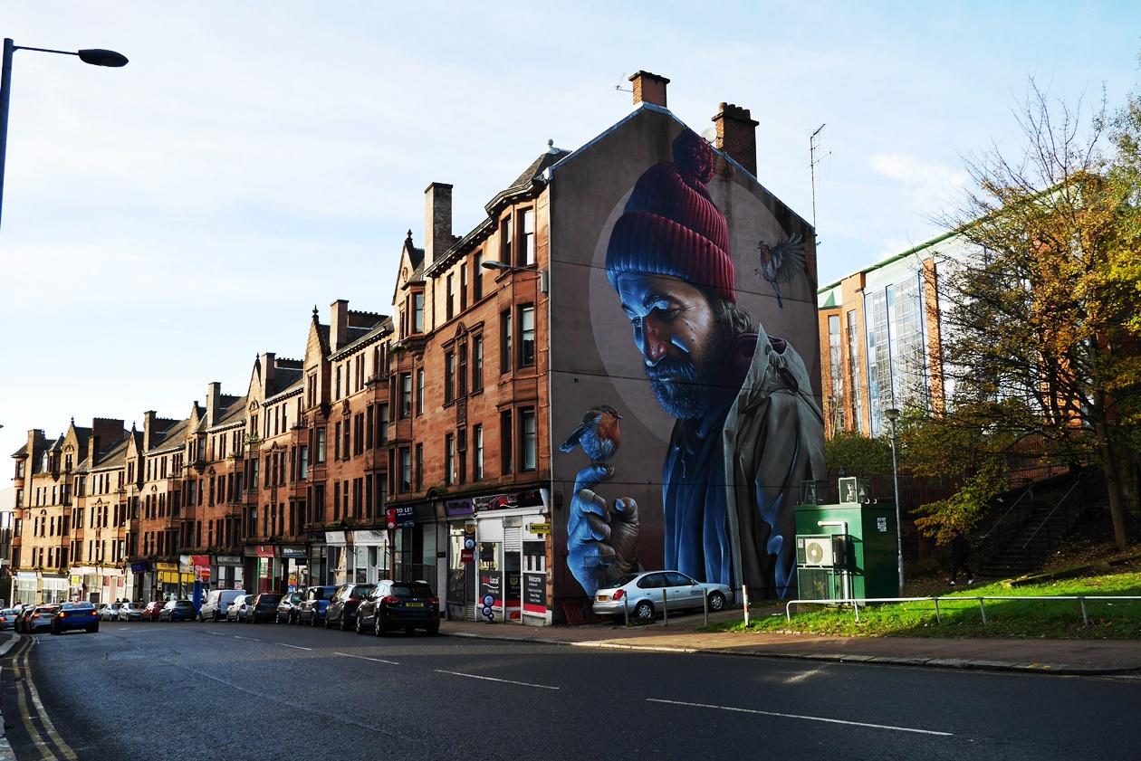 Häuserwand mit Streetart entdeckt auf einer Streetart Tour durch Glasgow